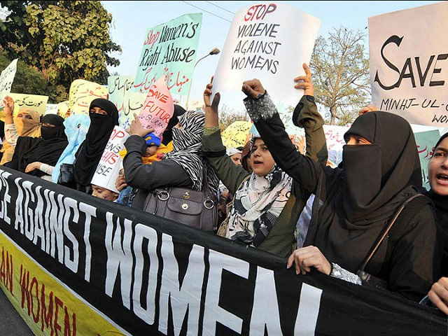 Supporters of Tehrik-e-Minhaj ul Quran, an Islamic Organisation protest against 'honour killing' of women in Lahore on November 21, 2008. Human rights lawyer Zia Awan said that more than 62,000 cases of women abused in Pakistan since the year 2000 and 159 women died in honour killings in the year to September 30. AFP PHOTO/Arif ALI (Photo credit should read Arif Ali/AFP/Getty Images)
