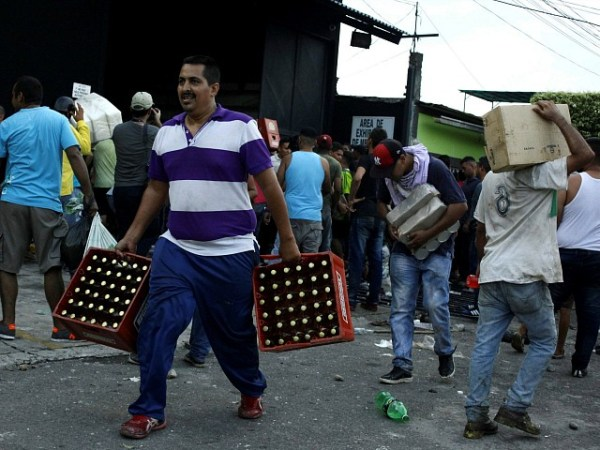 Hundreds, Including Police, Arrested for Looting in Venezuela