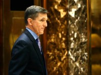 Michael T. Flynn, President-elect Donald Trump's choice for National Security Advisor, waits for an elevator at Trump Tower, Monday, Dec. 12, 2016, in New York. (AP Photo/Kathy Willens)