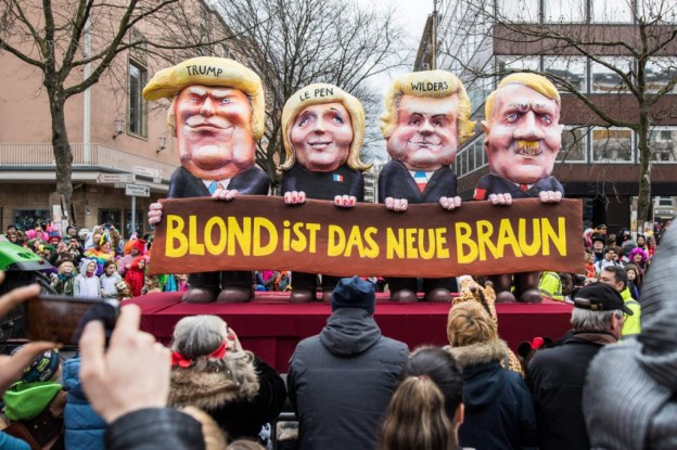 DUSSELDORF, GERMANY - FEBRUARY 27: A float featuring U.S. President Donald Trump (L-R), Marine Le Pen of Front National, Geert Wilders of Partij voor de Vrijheid and Adolf Hitler drives in the annual Rose Monday parade on February 27, 2017 in Dusseldorf, Germany. Political satire is a traditional cornerstone of the annual parades and the ascension of Trump to the U.S. presidency, the rise of the populist far-right across Europe and the upcoming national elections in Germany provided rich fodder for float designers this year. (Photo by Lukas Schulze/Getty Images)