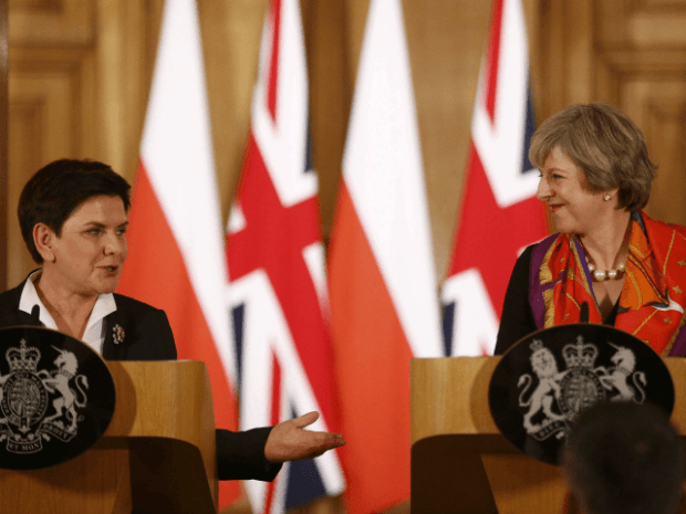 British Prime Minister Theresa May (R) and Polish Prime Minister Beata Szydlo attend a joint press conference following their meeting at 10 Downing Street in central London on November 28, 2016.
