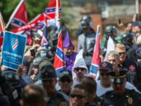 "Members of the Ku Klux Klan and others arrive for a rally July 8, 2017, calling for the protection of Southern Confederate monuments, in Charlottesville, Virginia, just a month before the August 11, 2017 ""Unite the Right"" rally in the same city"