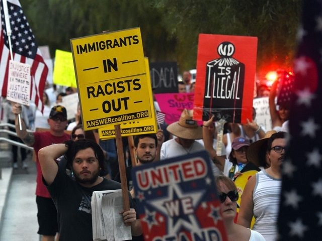 """Immigrants and supporters chant during a """"We Rise for the Dream"""" rally to oppose U.S. President Donald Trump's order to end DACA near the Trump International Hotel & Tower Las Vegas on September 10, 2017 in Las Vegas, Nevada. The Obama-era Deferred Action for Childhood Arrivals program protects young immigrants who grew up in the U.S. after arriving with their undocumented parents from deportation to a foreign country. Trump's executive order removes protection for about 800,000 current """"dreamers,"""" about 13,000 of whom live in Nevada. Congress has the option to replace the policy with legislation before DACA expires on March 5, 2018."""
