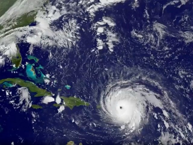 In this GOES-13 satellite image taken Wednesday, Sept. 6, 2017 at 7:15 a.m. EDT, and released by NASA/NOAA GOES Project, Hurricane Irma tracks over Saint Martin and the Leeward Islands. Hurricane Irma roared into the Caribbean with record force early Wednesday, its 185-mph winds shaking homes and flooding buildings on …