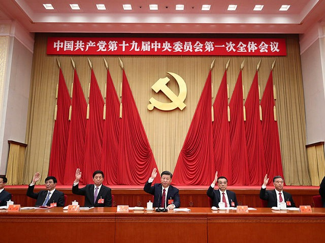 BEIJING, Oct. 25, 2017 -- Xi Jinping (C), Li Keqiang (3rd R), Li Zhanshu (3rd L), Wang Yang (2nd R), Wang Huning (2nd L), Zhao Leji (1st R) and Han Zheng (1st L) attend the first plenary session of the 19th Communist Party of China (CPC) Central Committee at the Great Hall of the People in Beijing, capital of China, Oct. 25, 2017. (Xinhua/Ju Peng via Getty Images)
