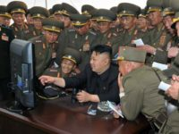 This undated picture released by North Korea's official Korean Central News Agency on April 27, 2014 shows North Korean leader Kim Jong-Un (C) visiting a military base