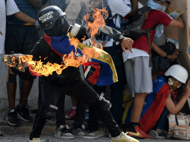 Opposition activists clash with                  the police during a demonstration marking 100 days of                  protests against Venezuelan President Nicolas Maduro                  in Caracas, on July 9, 2017. AFP/Federico Parra