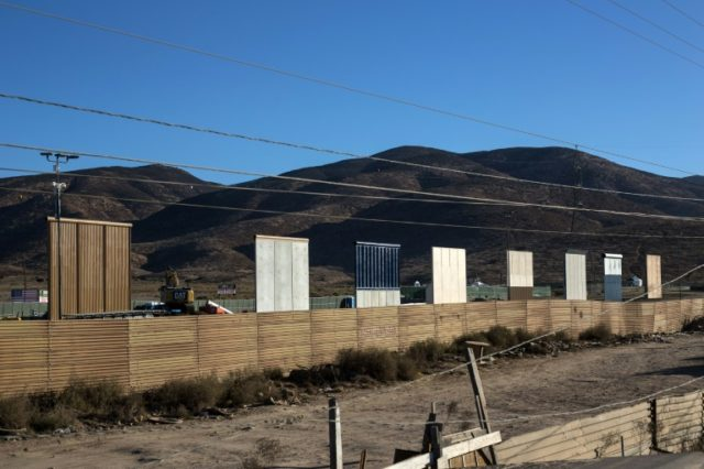 Eigth prototypes of US President Donald Trump's border wall being built near San Diego are seen from across the border in Mexico