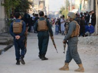 Afghan security forces stand guard near the site of a suicide attack in Jalalabad on November 23, 2017. A suicide bomber struck at a crowd of people in the eastern Afghan province of Nangarhar on November 23 killing at least eight, officials said, in an attack that underscored worsening security. The bomber approached the crowd of dozens on foot in provincial capital Jalalabad as they were demonstrating in support of a local police commander who had been sacked and calling for his reinstatement, provincial spokesman Attaullah Khogyani said. / AFP PHOTO / Noorullah SHIRZADA (Photo credit should read NOORULLAH SHIRZADA/AFP/Getty Images)