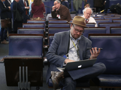 WASHINGTON, DC - FEBRUARY 24: New York Times reporter Glenn Thrush works in the Brady Briefing Room after being excluded from a press gaggle by White House Press Secretary Sean Spicer, on February 24, 2017 in Washington, DC. The New York Times, Los Angeles Times, CNN and Politico were also excluded from the off camera gaggle. (Photo by Mark Wilson/Getty Images)