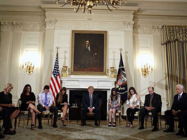 President Donald Trump hosts a listening session with high school students and teachers in the State Dining Room of the White House in Washington, Wednesday, Feb. 21, 2018. (AP Photo/Carolyn Kaster)