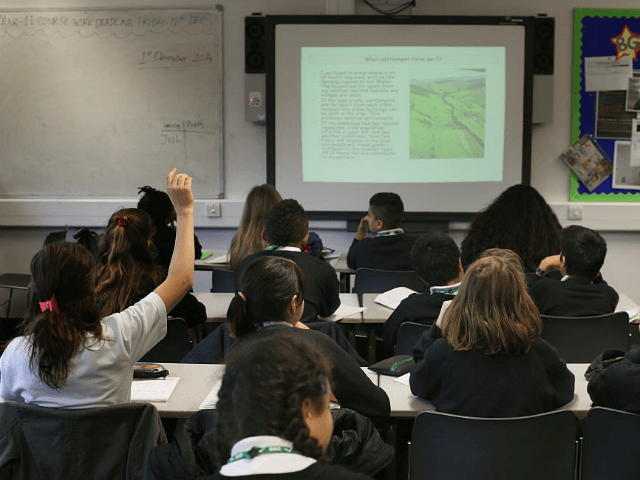 Students take part in a geography lesson at a secondary school on December 1, 2014 in London, England.