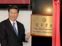 China's Vice President Xi Jinping unveils the plaque at the opening of Australia's first Chinese Medicine Confucius Institute at the RMIT University in Melbourne on June 20, 2010. The Confucius Institute will promote the study of Chinese culture and language with a focus on Chinese Medicine - one of the world's oldest and longest standing healthcare systems, tracing back more than 2,500 years. Xi is on a five-day visit to Australia. AFP PHOTO/William WEST (Photo credit should read WILLIAM WEST/AFP/Getty Images)