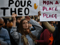 Protesters hold banners during a demonstration against police brutality on February 18, 2017 on the place de la Republique in Paris, following the alleged rape of a black youth, identified only as Theo, with a police baton, an incident that has sparked 10 nights of rioting and more than 200 arrests. The injuries sustained by Theo during a stop-and-search operation on February 2 in the suburb of Aulnay-sous-Bois, has revived long-simmering frustrations over policing in immigrant communities, where young men accuse the police of repeatedly targeting them in aggressive stop-and-search operations and using excessive force during arrests. / AFP / Lionel BONAVENTURE (Photo credit should read LIONEL BONAVENTURE/AFP/Getty Images)