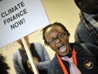 A climate activist shouts slogans during a demonstration at the Bella Center of Copenhagen on December 16, 2009 during the COP15 UN Climate Change Conference. AFP PHOTO / ATTILA KISBENEDEK (Photo credit should read ATTILA KISBENEDEK/AFP/Getty Images)