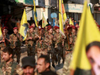 Kurdish People's Protection Units (YPG) military police members demonstrate with their flags and others bearing the portrait of Kurdistan Worker's Party (PKK) leader Abdullah Ocalan in the Kurdish town of Al-Muabbadah in the northeastern part of Hassakah province on February 24, 2018, denouncing the Turkish military operation against YPG forces in the northwestern Kurdish enclave of Afrin. / AFP PHOTO / Delil souleiman (Photo credit should read DELIL SOULEIMAN/AFP/Getty Images)