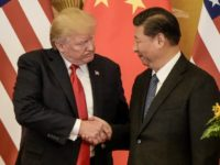 US President Donald Trump (L) has a delicate relationship with Chinese leader Xi Jinping, with whom he has claimed a