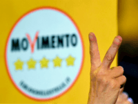 A supporter of the Italy's populist Five Star Movement (M5S) flashes the v for victory sign after the last election campaign meeting in Piazza del Popolo in Rome on March 2, 2018. Italy's anti-establishment Five Star Movement broke with tradition on March 1, 2018, by announcing its list of ministerial candidates, almost all of them political newcomers, before March 4 general election. / AFP PHOTO / Andreas SOLARO (Photo credit should read ANDREAS SOLARO/AFP/Getty Images)