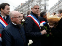 Politicians including LR MP Eric Ciotti (2L), LR president Laurent Wauquiez (C) and others prepare to take part in a slient march in Paris on March 28, 2018, in memory of Mireille Knoll, an 85-year-old Jewish woman murdered in her home in what police believe was an anti-Semitic attack. The partly burned body of Mireille Knoll, who escaped the mass deportation of Jews from Paris during World War II, was found in her small apartment in the east of the city on March 23, by firefighters called to extinguish a blaze. / AFP PHOTO / FRANCOIS GUILLOT (Photo credit should read FRANCOIS GUILLOT/AFP/Getty Images)