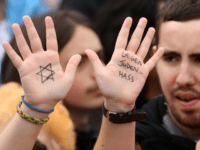 A visitor with with a Star of David and the words 'Against Hatred Toward Jews' written on her hands attends a rally against anti-Semitism on September 14, 2014 in Berlin, Germany. With the slogan 'Stand Up! Never Again Hatred Towards Jews' ('Steh auf! Nie wieder Judenhass'), the Central Council of Jews in Germany (Zentralrat der Juden) organized the demonstration after anti-Semitic incidents in the country occurring in the wake of the conflict in Gaza this summer, in which more than 2,000 Palestinians were killed by the Israeli government, the majority of whom were civilians, according to Palestinian authorities. (Photo by Adam Berry/Getty Images)