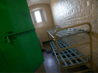 A cell is pictured inside Reading prison during an exhibition photocall at the prison in Reading, west of London on September 1, 2016. Having closed it's doors as a conventional prison in 2013, Reading Prison opens to the public for a major new project in which leading artists, performers and writers respond to the work of the prison's most famous inmate Oscar Wilde. / AFP / JUSTIN TALLIS (Photo credit should read JUSTIN TALLIS/AFP/Getty Images)