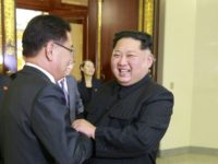 North Korean leader Kim Jong Un (R) shakes hands with South Korean chief delegate Chung Eui-yong during their meeting in Pyongyang