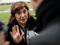 Syrian senior presidential advisor Buthaina Shaaban gestures as she answers a question from a journalist on Syrian peace talks at the United Nations on January 29, 2014 in Geneva. Syria's opposition said peace talks with President Bashar al-Assad's regime in Geneva took a step forward on January 29 with discussions on a transitional government after four days of deadlock. AFP PHOTO / FABRICE COFFRINI (Photo credit should read FABRICE COFFRINI/AFP/Getty Images)
