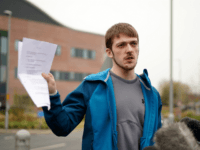LIVERPOOL, ENGLAND - APRIL 13: Tom Evans, the father of terminally ill 23-month-old Alfie Evans, holds up a court order as he speaks to the media outside Alder Hey Hospital where Alfie is being cared for on April 13, 2018 in Liverpool, England. Tom Evans and Kate James the parents of Alfie are preparing a fresh request to Court of Appeal judges to allow 23-month-old Alfie Evans to continue to receive treatment at the Bambino Gesu hospital in Italy. (Photo by Christopher Furlong/Getty Images)