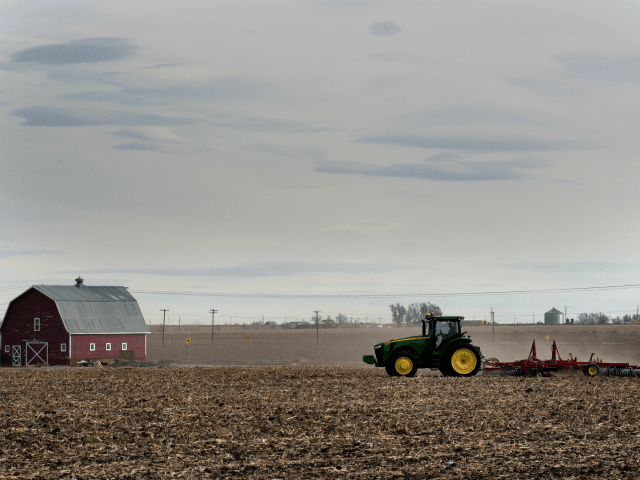 A farmer plows his fields in the small northeastern agricultural town of Eaton, Colorado, on February 10, 2017. With a population of just over 5,000 residents, 71% of the town's registered voters cast their ballots in support of President Donald Trump during the 2016 US presidential election. / AFP PHOTO / Jason Connolly (Photo credit should read JASON CONNOLLY/AFP/Getty Images)
