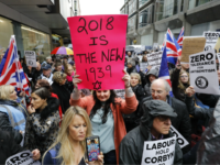 People hold up placards and Union flags as they gather for a demonstration organised by the Campaign Against Anti-Semitism outside the head office of the British opposition Labour Party in central London on April 8, 2018. Labour leader Jeremy Corbyn has been under increasing pressure to address multiple allegations of anti-Semitism within the party, which saw protesters gather outside the party's head office in London after Jewish campaigners demonstrated outside parliament two weeks ago. / AFP PHOTO / Tolga AKMEN (Photo credit should read TOLGA AKMEN/AFP/Getty Images)