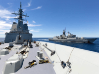 HMA Ships Anzac and Hobart perform a replenishment at sea off the east coast of Australia.