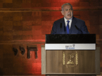 Israeli Prime Minister Benjamin Netanyahu speaks during the Holocaust Remembrance Day ceremony at the Yad Vashem Holocaust memorial in Jerusalem, Wednesday, April 11, 2018. Israel is commemorating its Holocaust Remembrance Day in memory of the 6 million Jews systematically killed by Nazi Germany and its collaborators during World War II. (AP Photo/Tsafrir Abayov)