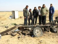 Palestinian men look at the debris of a tuk tuk vehicle at the site of an explosion east of Rafah in the southern Gaza Strip, on April 14, 2018. Four members of Islamic Jihad died in the blast (AFP PHOTO / SAID KHATIB)