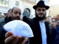 A man shows a kippa during the 'Berlin wears kippa' event, with more than 2,000 Jews and non-Jews wearing the traditional skullcap to show solidarity with Jews on April 25, 2018 in Berlin after Germany has been rocked by a series of anti-Semitic incidents. - Germans stage shows of solidarity with Jews after a spate of shocking anti-Semitic assaults, raising pointed questions about Berlin's ability to protect its burgeoning Jewish community seven decades after the Holocaust. (Photo by Tobias SCHWARZ / AFP) (Photo credit should read TOBIAS SCHWARZ/AFP/Getty Images)