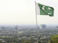 ISLAMABAD, PAKISTAN - MARCH 14: An aerial view of city scape is seen as a Pakistani flag is wawing in Islamabad, Pakistan on March 14, 2018. City staff prepared the city surroundings for being ready for celebrations of 23rd March Pakistan's National Day. Islamabad, being the capital city of Pakistan till 60s, is sectored in grids via trees in clean streets. Pakistan located on the Himalayan foothills and the Margalla Hills. There are many historical and significant places like the Faisal Mosque, Rawal Dam, Damanico Hill. (Photo by Muhammed Semih Ugurlu/Anadolu Agency/Getty Images)