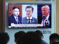 In this Wednesday, April 18, 2018, file photo, people watch a TV screen showing file footage of U.S. President Donald Trump, right, South Korean President Moon Jae-in and North Korean leader Kim Jong Un, left, during a news program at the Seoul Railway Station in Seoul, South Korea. The upcoming meeting between the leaders of the rival Koreas will be the ultimate test of Moon s belief that his nation should lead international efforts to deal with North Korea.The signs read: