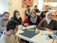 KLADESHOLMEN, SWEDEN - FEBRUARY 10: Refugees attend to Swedish language class at the temporary house for asylum seekers of the Vattendroppen school on February 10, 2016 in Kladesholmen, Sweden. Last year Sweden received 162,877 asylum applications, more than any European country proportionate to its population. According to the Swedish Migration Agency, Sweden housed more than 180,000 people in 2015, more than double the total in 2014. The country is struggling to house refugees in proper conditions during the harsh winter; summer holiday resorts, old schools and private buildings are being turned into temporary shelters for asylum seekers as they wait for a decision on their asylum application. Sweden is facing new challenges on its migration policy after the massive arrival of refugees last year, forcing the country to drastically reduce the number of refugees passing through its borders. Stricter controls have had a significant effect on the number of arrivals, reducing weekly numbers from 10,000 to 800. The Swedish migration minister announced in January that the government will reject up to 80,000 refugees who applied for asylum last year, proposing strict new residency rules. (Photo by David Ramos/Getty Images)