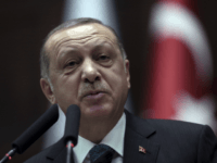 """Turkish President Recep Tayyip Erdogan addresses the members of his ruling party at the parliament in Ankara, Turkey, Tuesday, March 20, 2018. Erdogan has called on the United States to """"show respect"""" and """"walk with"""" its NATO ally, in new criticism of Washington over its engagement with Syrian Kurdish militia. Erdogan's comments on Tuesday were in reply to statements from the U.S. State Departments voicing concern over Turkey's cross border offensive in northwestern Syrian enclave of Afrin, which Turkish troops and allied Syrian forces captured from the Syrian militia on Sunday.(AP Photo/Burhan Ozbilici)"""
