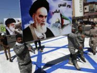In this June 23, 2017 file photo, supporters of Iraqi Hezbollah brigades march on a representation of an Israeli flag with a portrait of late Iranian leader Ayatollah Khomeini and Iran's supreme leader Ayatollah Ali Khamenei, in Baghdad, Iraq. There may not be much Iran can do about President Donald Trumps withdrawal from the nuclear deal, but across the Middle East, the Islamic Republic has a variety of ways it can hit back at the United States and Americas regional allies. Iran sponsors a range of Shiite militias in Iraq and enjoys deep ties to the countrys economy and political system. (AP Photo/Hadi Mizban, File)