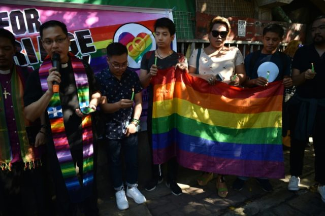 Members of the LGBT community take part in a rally in front of the Supreme Court in Manila as the case is heard