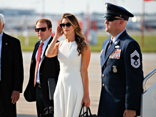 Hope Hicks stands on the tarmac as President Donald Trump is greeted as he arrives on Air Force One at John Glenn Columbus International Airport in Columbus, Ohio, Saturday, Aug. 4, 2018, en route to a rally at Olentangy Orange High School in Lewis Center, Ohio.