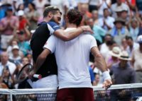 Old pals act: Roger Federer and Benoit Paire embrace