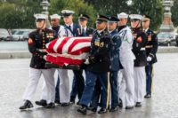 A military honor guard team carries the flag-draped casket of the late US Senator John McCain, Republican of Arizona, at the US Capitol in Washington
