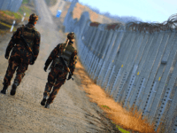 Border soldiers patrol along the border fence at the Hungarian-Serbian border near Hercegszanto border station on December 14, 2017. Since July 2015 Hungary secured the more than 300-km-long border to Serbia with the construction of a fence and 24 hours a day security patrol tasks. Several thousand soldiers participate in …