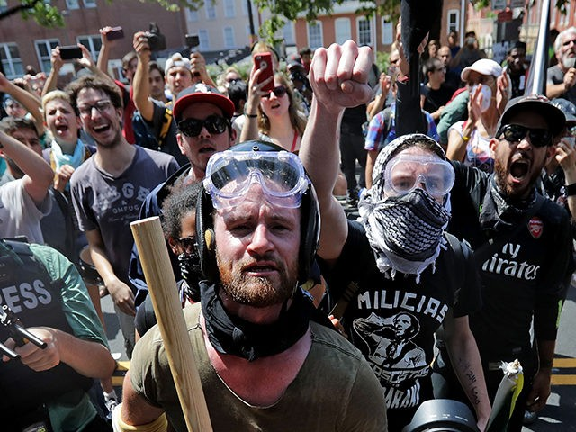 CHARLOTTESVILLE, VA - AUGUST 12: Anti-fascist counter-protesters wait outside Emancipation Park to hurl insluts as white nationalists, neo-Nazis and members of the 'alt-right' are forced out after the 'Unite the Right' rally was declared an unlawful gathering August 12, 2017 in Charlottesville, Virginia. After clashes with anti-fascist protesters and police …