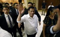 Philippine President Rodrigo Duterte waves on his arrival in Jerusalem at the start of an official visit to Israel, on September 2, 2018