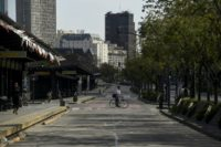 A man rides his bike across the empty 9 de Julio avenue in Buenos Aires, during a 24-hour general strike on September 25, 2018