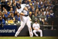 Jesus Aguilar drives in a run as the Milwaukee Brewers overpower the Los Angeles Dodgers to level their National League Championship Series on Friday