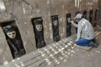 An expert works on excavation of the ceremonial corridor where 20 pre-Columbian wooden statues were found