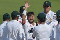 Record breaker: Record breaker: Pakistani spinner Yasir Shah celebrates taking his 200th Test wicket against New Zealand on Thursday